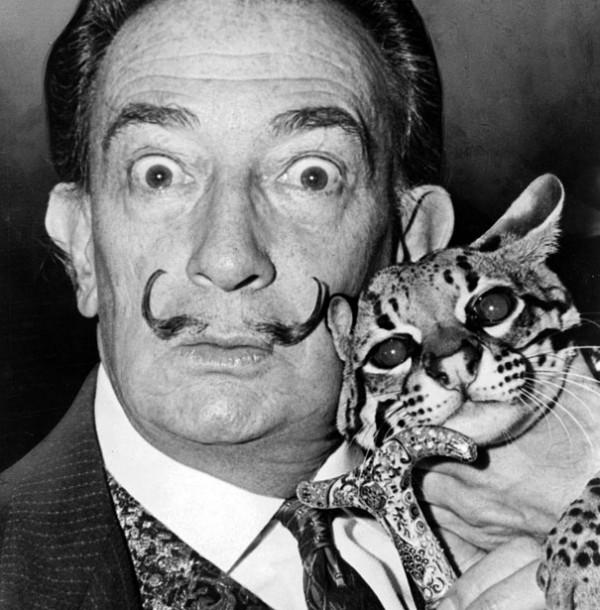 Salvador Dalí with his pet ocelot, Babou